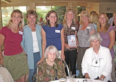 Left to right: Catherine Cavagnaro, Elaine Huf, Evelyn Bryan Johnson, Sarah Kelly, Sparky Barnes Sargent (holding a copy of the book she authored, A Hunger for the Sky), Sandy Mercandetti, Jeanie Collins, and Sheila Mabbitt.