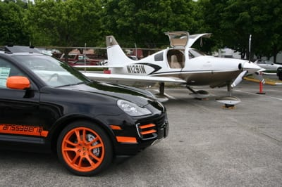 Porsche Cayenne in front of Cessna Corvalis TT at the Galvin Flying hosted Piston Aircraft Expo.