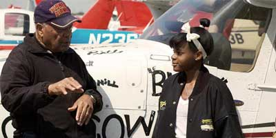 Tuskegee Airman Levi Thornhill and teen-age pilot Kimberley Anyadike talk about flying.