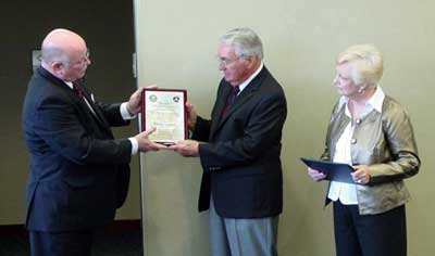 Paul Siedenburg (center) is presented his award by Larry Arenholz from the Des Moines FSDO while Paul's wife, Minnette, looks on.