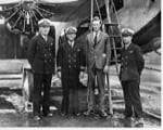 Preparing for the first east-bound TAT Air-Rail coast-to-coast service is pilot Charles Lindbergh (second from right) and co-pilot Eddie Bellande (on Lindbergh's right).
