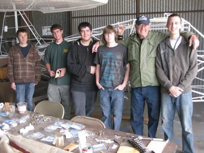 Working on the restoration of Stits Skycoupe are (left to right) Leland Spearman, Alex Lemke, Nathan Sandoval, Christian Krause, Al Gester, and Jonathan Lane. Not shown are Kyle Appleberry and Jacob Hilger.