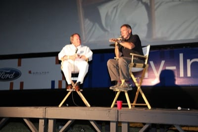 Ford Motor Co. chairman Edsel Ford (left) and actor/pilot Harrison Ford introduce a movie at last year's AirVenture.
