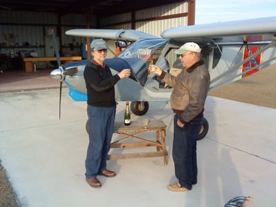 Clem Kramer celebrates the first flight of his homebuilt with his friend Dave Miner.