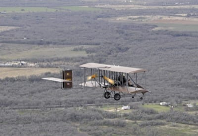 """Pilots Rich Stepler and Don Stroud in the Wright """"B"""" Flyer No. 001"""