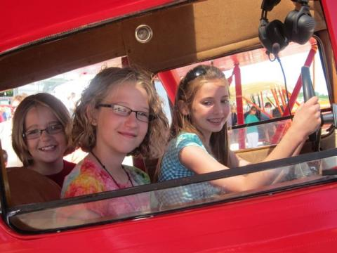 Young aviation enthusiasts enjoy the Waco YKS at Watertown.