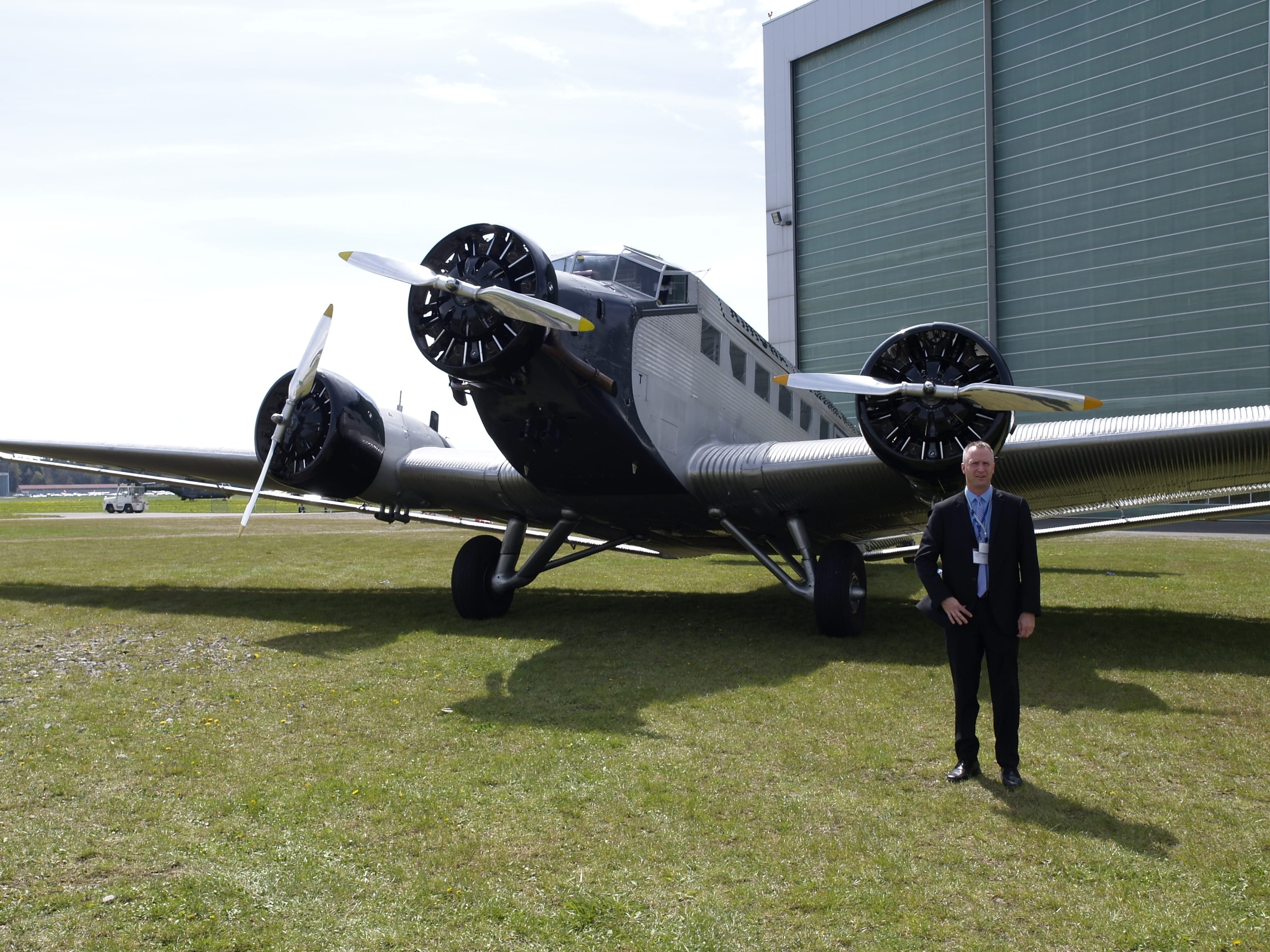 The RIMOWA Junkers JU 52 tri-motor, with EAA's Jeff Kaufman, after the April 19 announcement in Germany that AirVenture would be included on the airplane's North American tour. (photo by Marino Boric)