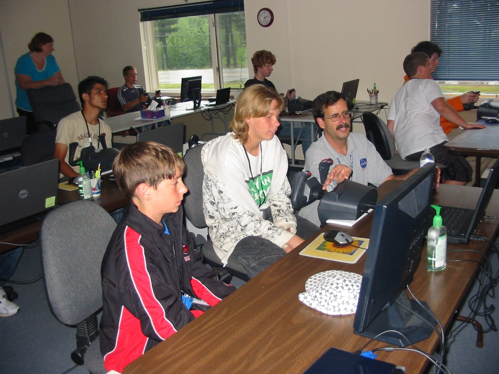 Students attending Winnaero's ACE Academy located at Laconia Airport in Gilford, N.H., learn the fundamentals of aviation from Project Director Dan Caron.  Photo courtesy Winnaero