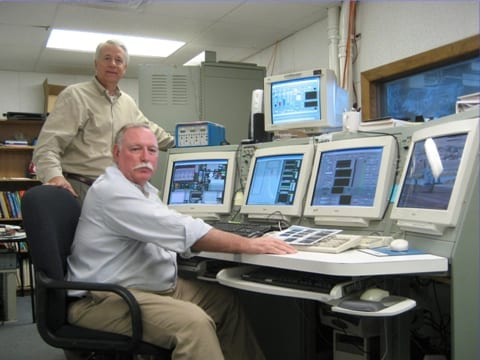 GAMI's Tim Roehl (in back) and George Braly in the company's test cell.