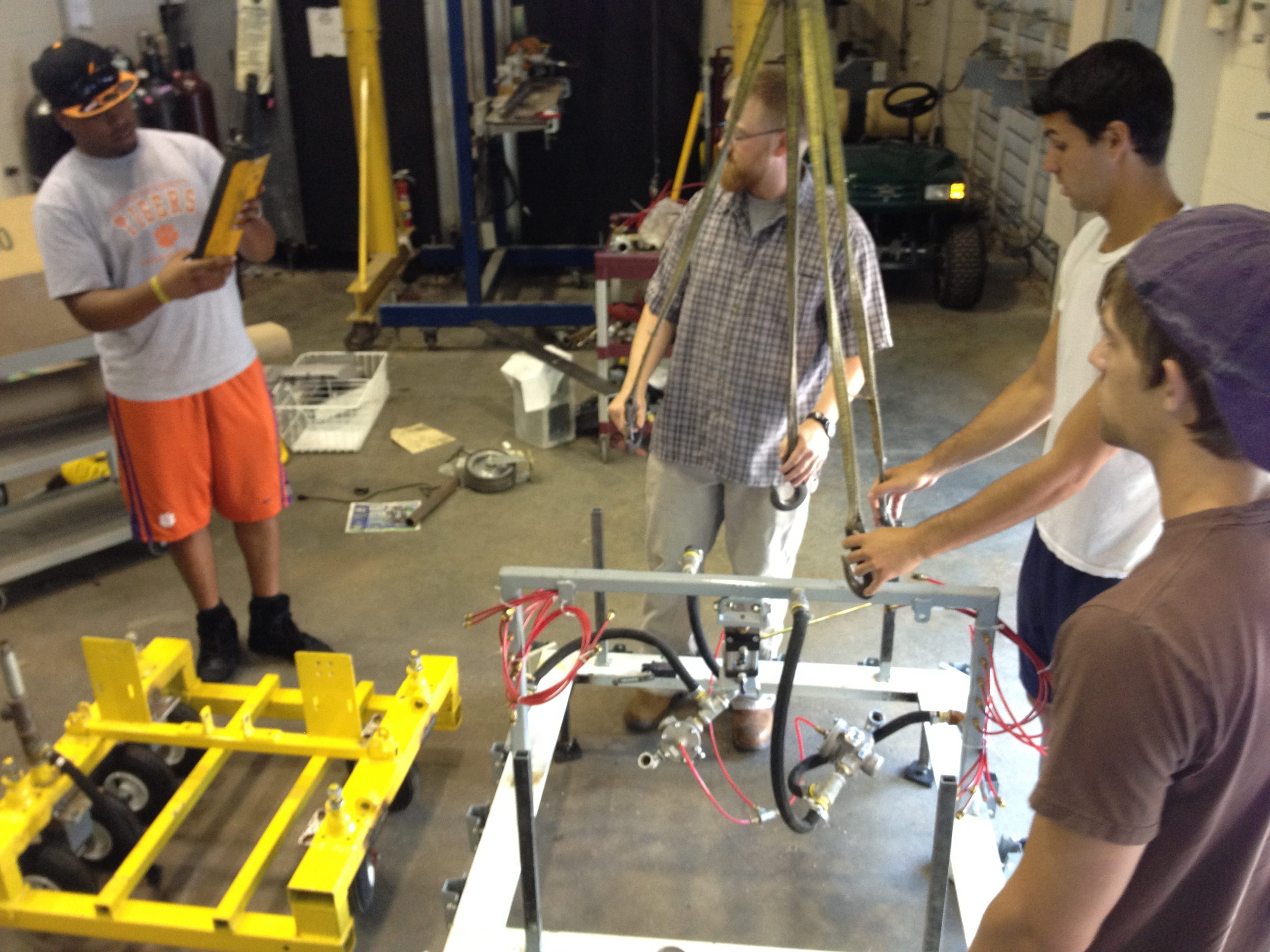 Clemson student researchers reassemble the mobile drill press. Photo by Gregory Mocko