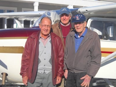 Image 028: Bill Seed, center, president of WinnAero, is joined by Donald Flanders, left, a member of the Laconia Airport Authority and state representative from Laconia, NH, and retired Air Force Col. Robert Fortnam, right. Fortnam drew the winning ticket for a Cessna Skyhawk raffled off to benefit WinnAero, an aviation/aerospace-based youth organization located at Laconia Municipal Airport in Gilford, New Hampshire.
