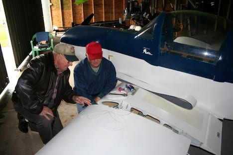 Lowell checks the fuel tank installation on a new homebuilt.