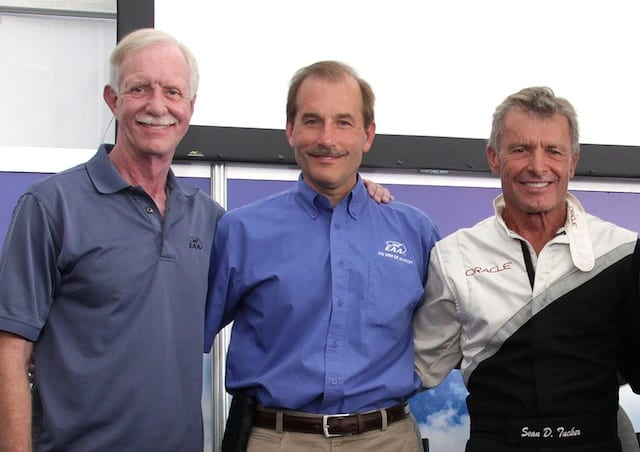 Outgoing EAA Young Eagles co-chairmen Sully Sullenberger (left) and Jeff Skiles (center) with new Young Eagles chairman Sean D. Tucker at an EAA AirVenture 2013 public appearance at Oshkosh, Wis., on Aug. 2, 2013. Sullenberger and Skiles served as Young Eagles co-chairmen since 2009. (EAA photo)