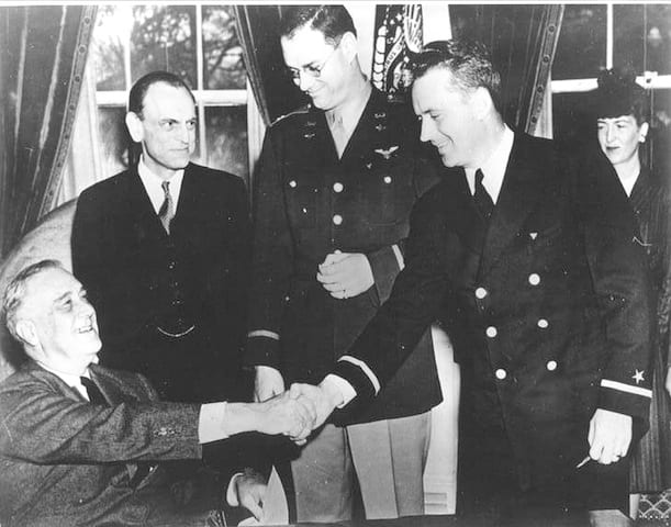 CAP Coastal Patrol Base 2's Eddie Edwards receives first WWII Air Medal to be presented by President Franklin D. Roosevelt.