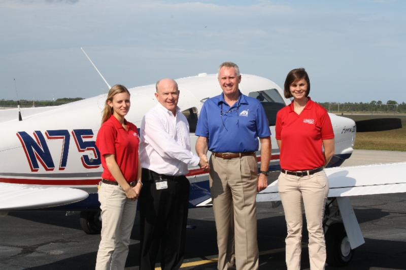 Simon Caldecott of Piper Aircraft with David Young of Liberty University