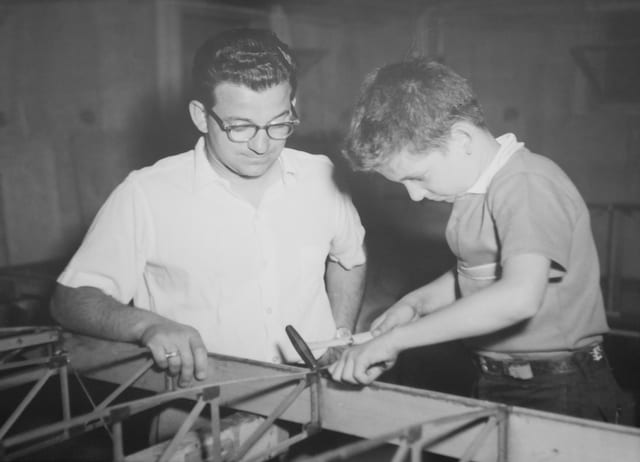 Lou Sr. supervising Lou Jr. during the building of the Baby Ace wing