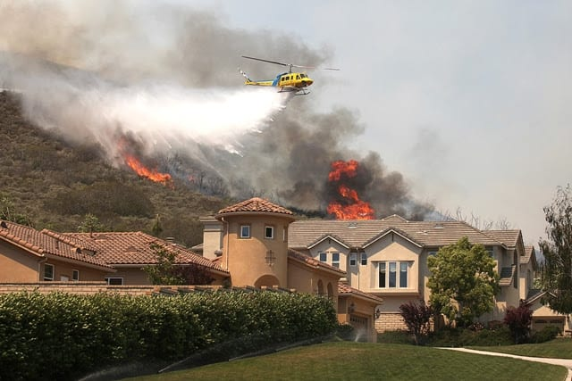 H:EDITORIALPhotos5 May 2013RG-05-02-13 RICHARD GILLARD/Acorn NewspapersA Ventura County Fire Support helicopter drops water in the Spring Fire on Via Mira Flores in Dos Vientos in Newbury Park on Thursday, May 2.