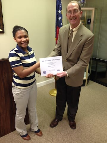 Columbus, Georgia student Kennedy Davenport (left) accepts scholarship to EAA Air Academy from EAA Chapter 677 president, Ernie Kelly (right).