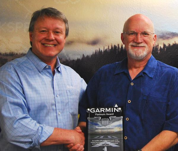 Wayne McGhee (left), Garmin Western US Regional Sales Manager, with Dewey Conroy, Pacific Coast Avionics Vice President and General Manager