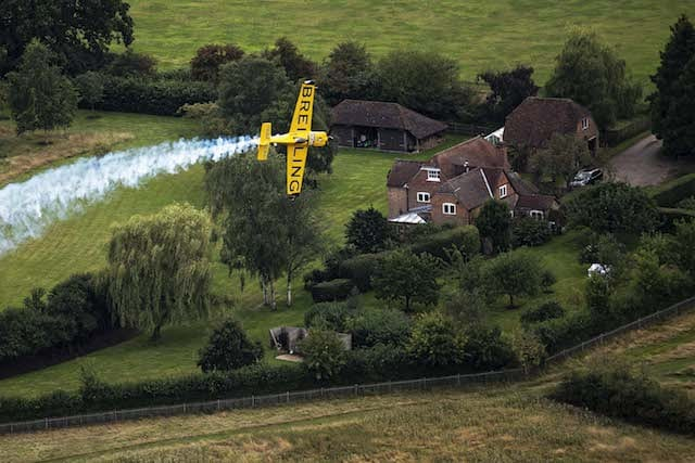 Nigel Lamb of Great Britain performs during the finals of the fifth stage of the Red Bull Air Race World Championship in Ascot, Great Britain on August 17, 2014.