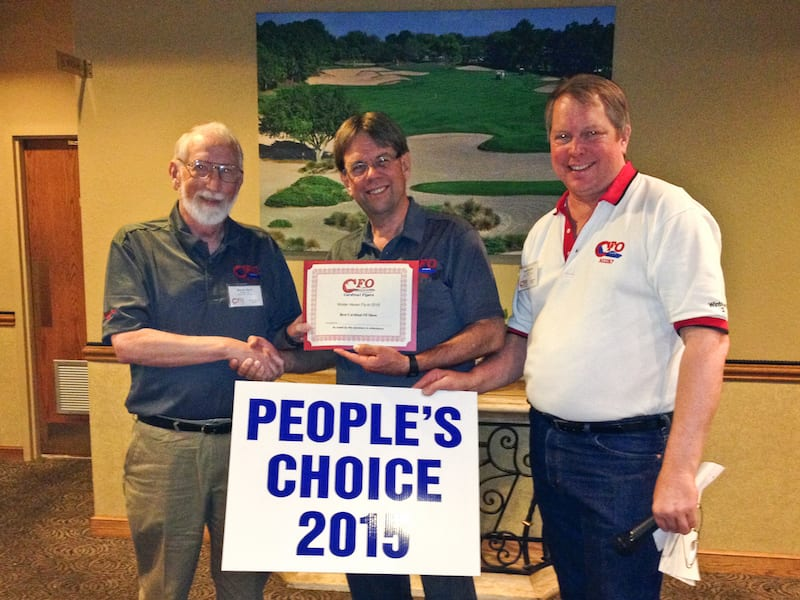 "Number 10: Woody Beck (Left) receives his award for the people's choice ""Nicest Cardinal"" award from Paul Millner (center) and Keith Peterson (right). The big sign is his reserved parking space marker for future fly-ins."