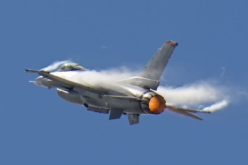 This F-16 Fighting Falcon generates vapor from the humid air as it pulls into a vertical maneuver during its demonstration.