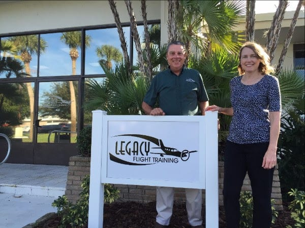 Legacy Flight Training, Inc. Owners Bill & Diane Inglis in front of new Vero Beach training center.