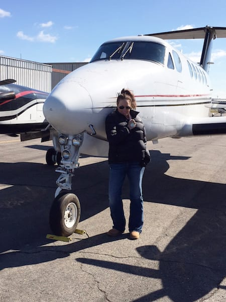 Photo 1 of Kelly Hicks with King Air to Accompany Previous AVTRIP Scholarship winner put 2013 award to good use Scholarship winner puts award to good use