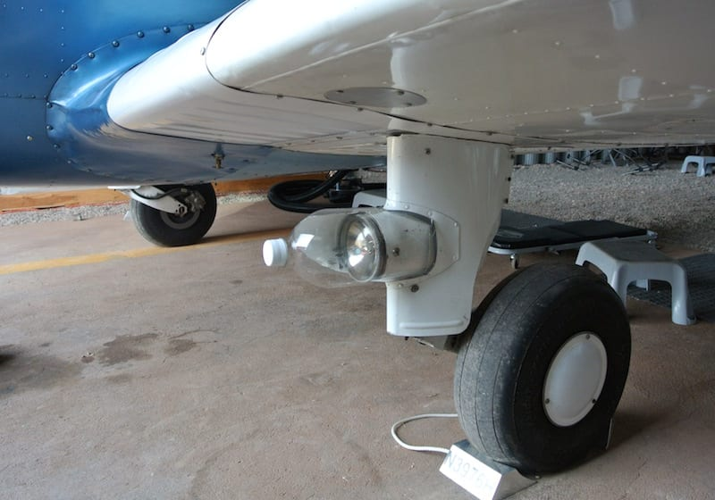 The super-high tech aerodynamic landing light cover. Yes, it's a three-liter soda bottle with the bottom cut off.