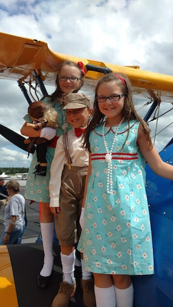 """Rhodes, Wills and Rhys Johnson dressed the part and welcomed """"Amelia Earhart"""" when she Revisted Greenville last Saturday at the Greenville Downtown Airport."""