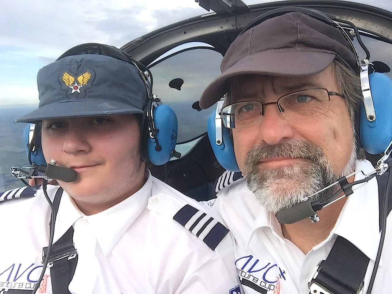 A happy moment early in the flight: Rio A. F. Dubois (left) pilots Race 53 shortly after take off, while pilot-in-command William E. Dubois scans the panel. 14-year-old Rio was the youngest certificated student pilot in this year's race, and one of the youngest in race history. (Photo by William E. Dubois)
