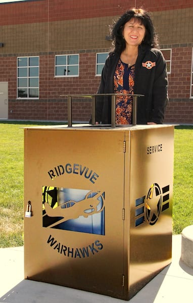 Principal Julie Yamamoto shows one of the campus fixtures that promotes the Warhawks ethos at the new Ridgevue High School in Nampa, Idaho. (Photo by Frederick A. Johnsen)