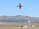 Voodoo rounds the home pylon for the final lap in the Unlimited Gold Race. With Steven Hinton at the controls the plane took first place this year with a speed of 460.306 miles per hour. While the second place plane wasn't even close, that wasn't true of all the races this year. In the T-6 Gold race, only a 20th of a second separated the first and second place planes. (Photo by William E. Dubois)