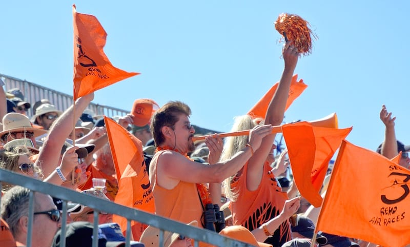 Section 3 fans, in their distinctive orange garb, are known for their enthusiasm. And for their rowdy behavior. (Photo by William E. Dubois)