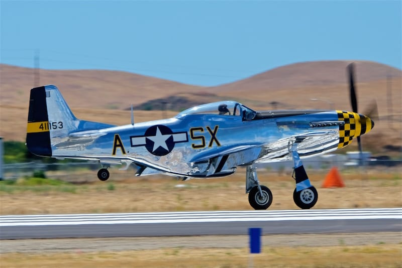 "One of many P-51's on display, ""Kimberly Kaye"" returns after a series of formation flybys."