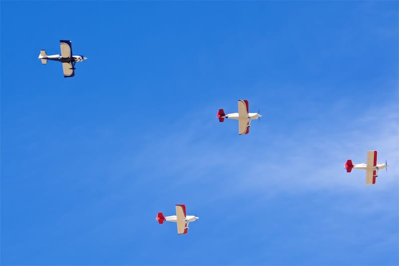 "The Harmon Rockets of the ""Bakersfield Bunch"" pass over Hollister airport in formation"