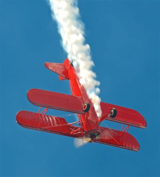 Vicky Benzing performing in her scarlet Stearman.