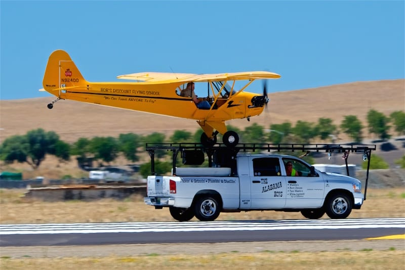 Greg Koontz sets his Piper Cub down on a truck as part of the Alabama Boys routine.