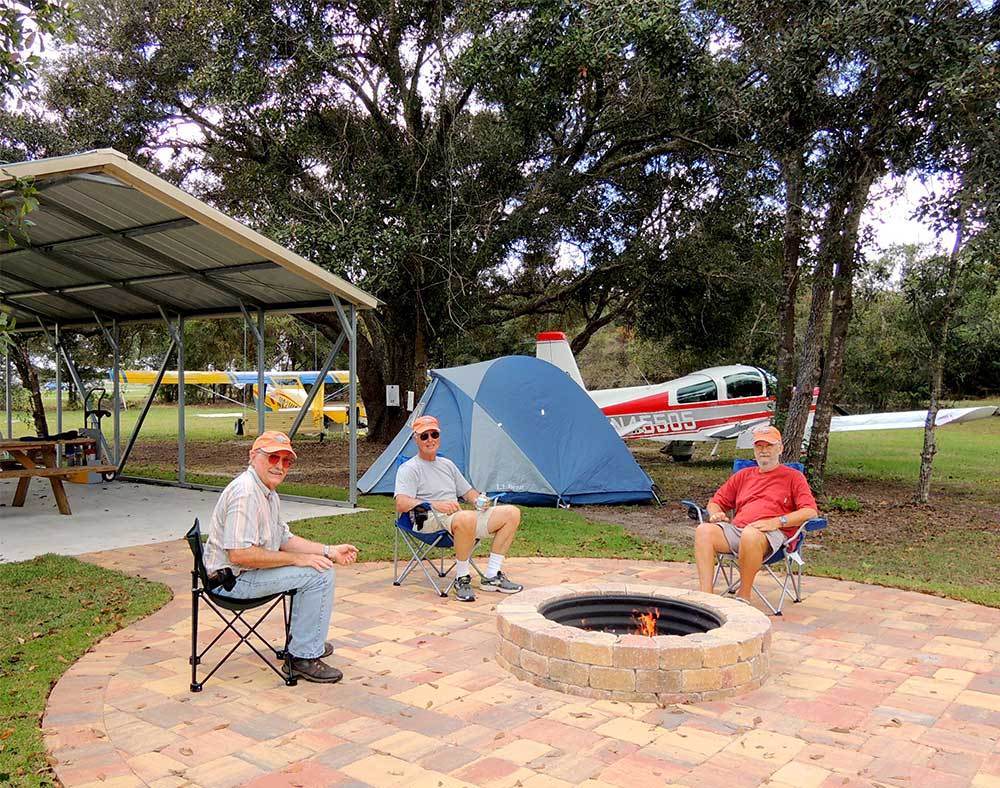 A permanent fire hub next to the 20'x30' picnic shelter makes for a welcoming setting at Arcadia Airport's Airport City campground.