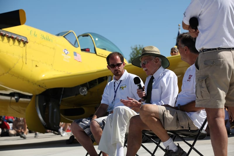 Bob Hoover Speaking in front of Ole Yeller P51 at a recent AirVenture. (Photo courtesy EAA)
