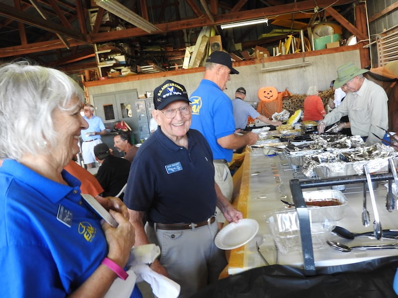EAA Chapter 534 members Joan Luebbers, Jack Hallett and Steve Barber enjoyed the chow served at the Bob White Field Fly-In.