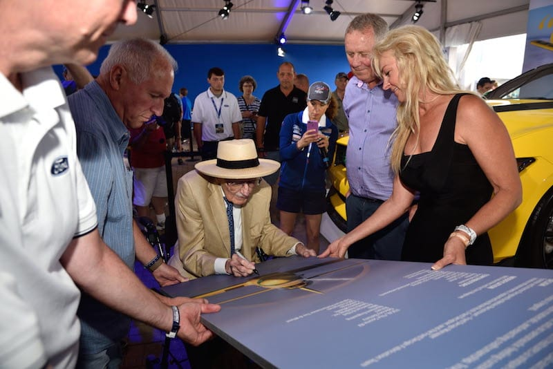 """Bob Hoover signs autographs at the premiere of """"Flying the Feathered Edge,"""" a documentary about the famed flyer. (Photo courtesy EAA)"""