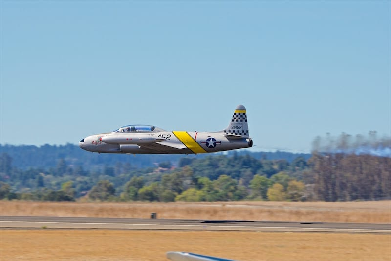 Greg Colyer performs a very low pass in his Lockheed T-33 Shooting Star during the show. In keeping with the Canadian theme of the show, this aircraft is actually a license-built Canadair CT-33.