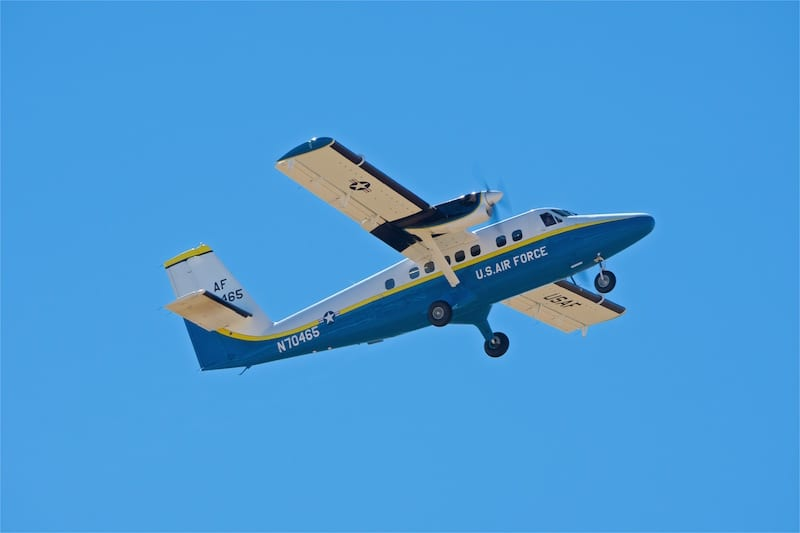 """A de Havilland Canada UV-18 Twin Otter carries the U.S. Air Force Skydiving Tem """"Wings of Blue"""" up to jump altitude."""