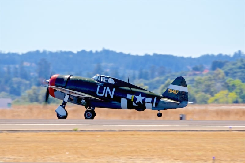 A Republic P-47G Thunderbolt, visiting from the Planes of Fame museum, rumbles into the air for some warbird flybys.