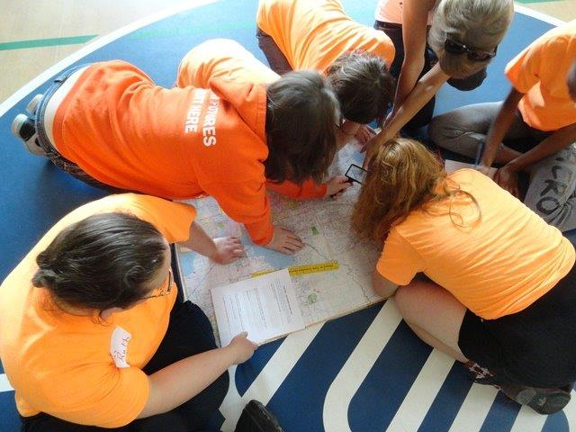 Girls practice using maps and charts in the No Limits Aviation Program. (Photo courtesy of Aviation Adventures, Inc.)