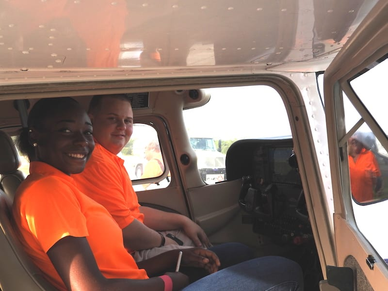 Spark members Kenesha Haugabrook and Jared Fincher get the feel of a single engine General Aviation aircraft at Sun Aviation located at the Leesburg International Airport.