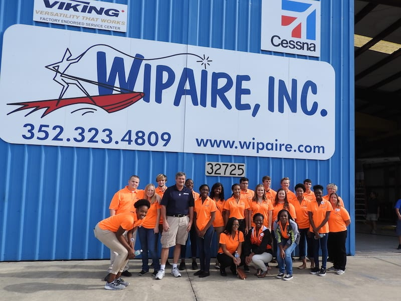 Bill Pike ( blue shirt ) was the Wipaire host for the Spark students.