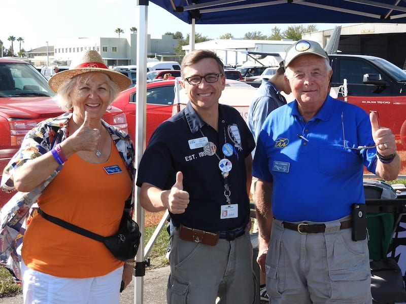 Joan Luebbers EAA Chapter 534, Charlie Becker EAA Director of Chapters, Communities & Homebuilt Community Manager and Ted Luebbers EAA Chapter 534 give thumbs up for the Sport Aviation Showcase.