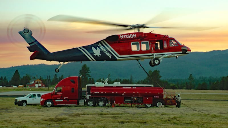 Firehawk variant of Blackhawk helicopter settles in for the evening at Cascade, Idaho, with smoke from the large Pioneer fire tinting the sunset on 21 August 2016. (Photo by Frederick A. Johnsen)